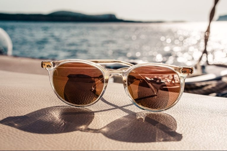 Photograph of sunglasses and summer scene